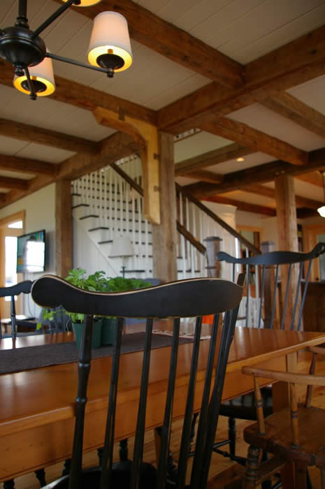 Hybrid Timber Frame dining area to stairs with Ship knee