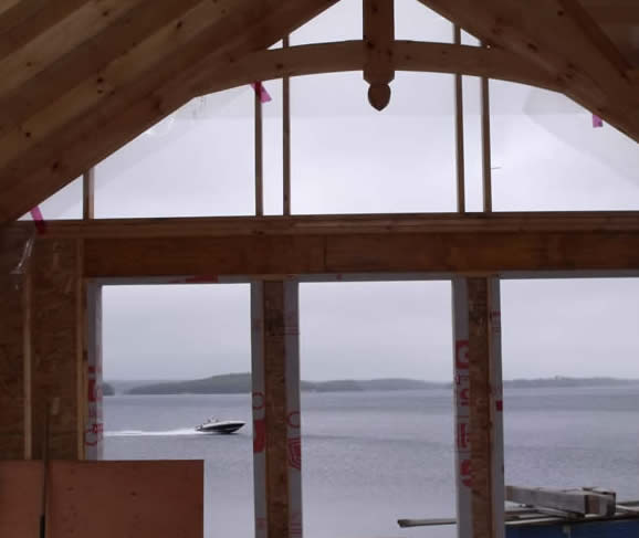 Timber Frame Great room with a view of the water