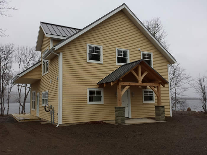 Completed Spruce Timber Frame with Cedar Timber Frame Entry