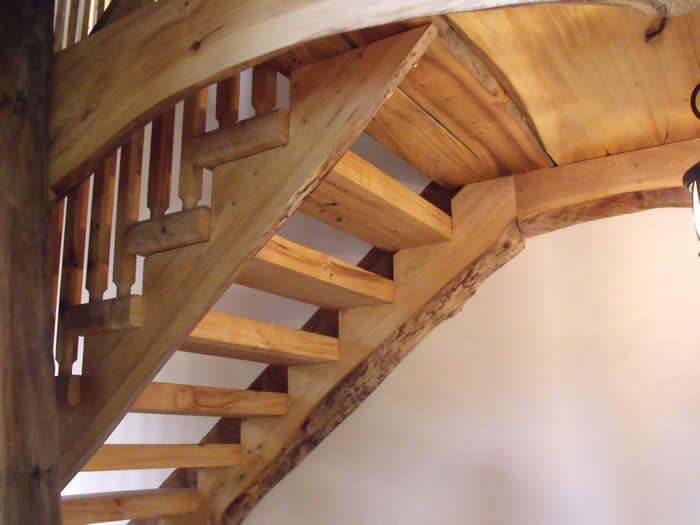 The elm stairs in the Heritage timber frame