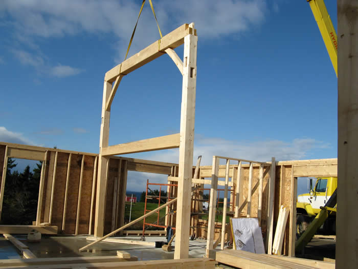 Timber Frame Bent lifted into place by a crane