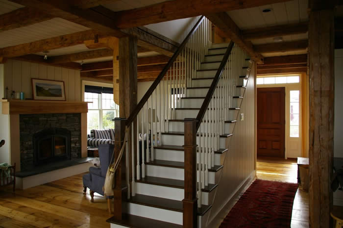 Timber Frame living room with stairs to the second floor
