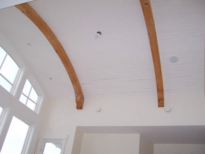 Curved rafters that interrupt white space