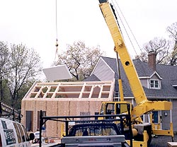 Timber framing - stress skin insulated panels clad the exterior